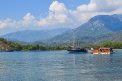 Two boats are moored in a bay. Mountains on the background. stock photos