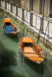Two boats moored in a canal in Venice Italy Royalty Free Stock Photos