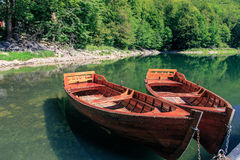 Two boats. On mountain lake Royalty Free Stock Photo
