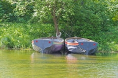Two boats on parking Stock Images