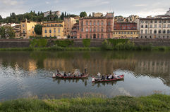 Two boats with people and gondoliers on the Arno Stock Image
