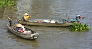 Two Boats at Phong Dien Floating Market Royalty Free Stock Images
