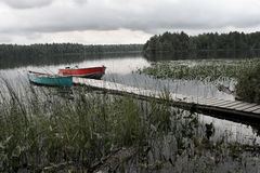Two boats on private lake. A place to take the family for rest and recreation Royalty Free Stock Photography