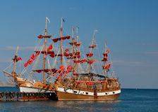 Two boats. With red sails preparing for the journey Royalty Free Stock Photo