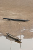 Two boats on the riverbed of Mekong Stock Images