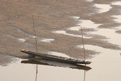 Two boats on the riverbed of Mekong Royalty Free Stock Photo