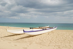 Two Boats on the Sand. Canoes on the sand Stock Photo