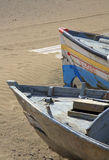Two boats on sandy beach Stock Photos