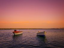 Two boats in the sea at Atakum Beach and the landscape behind them. stock photo