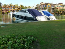 Two boats in Sotogrande resort. Scenic view of two boats, the gardens, the sea and beautiful apartments in Sotogrande resort, at the south of Spain Stock Photos