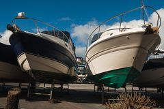 Two boats sticking out  for storing stand Royalty Free Stock Images