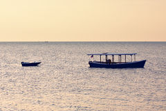 Two boats at sunrise Royalty Free Stock Photos