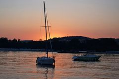 Two boats at sunset. Near the coastline of a small port of Primorsko royalty free stock image