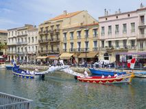 Two boats taking part in water jousting. In the city of Sete in southern France Stock Photography