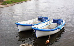 Two boats on the water. Two similar boats on the water Stock Photography