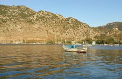 Two boats. Two white boats in the sea in Fethie Turkey with reflection and mountain on background Stock Photo