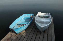 Two boats on wooden berth Royalty Free Stock Images