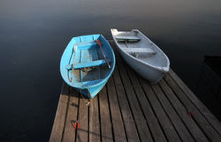 Two boats on wooden berth Royalty Free Stock Image