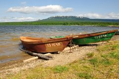 Two boats on Zuratkul lake Royalty Free Stock Images