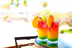 Two bocals of colorful cocktail Stock Images