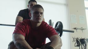 Two bodybuilders look in the camera stock footage