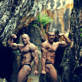 Two bodybuilders posing outdoors - copyspace Royalty Free Stock Photography