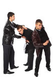 Two bodyguards protect businessman Stock Image