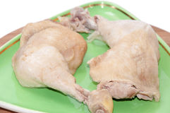 Two boiled chicken drumsticks served on a plate Royalty Free Stock Photography