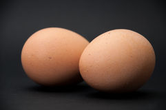 Two boiled eggs on the black background Royalty Free Stock Image