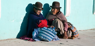 Two Bolivian women. Two poor bolivian women in the city of Uyuni on the Bolivian altoplano Royalty Free Stock Photography