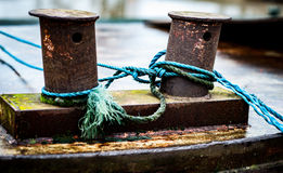 Two bollards and rope Stock Photos