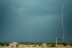 Two bolts. Of lightning strike farmland in central Kentucky Royalty Free Stock Photos