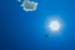 Two bombers fly up through the sun Stock Photography