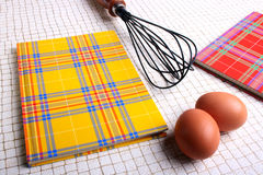Two books for recipes. On a kitchen table with eggs and a beater stock photography