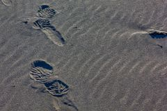Boot prints in sand Royalty Free Stock Photo