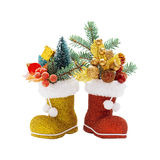 Two boots of Santa Claus with Christmas decorations Royalty Free Stock Photos