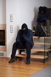 Two bored burglars. Two bored and resigned burglars waiting sitting on the stairs Royalty Free Stock Photo