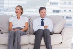Two bored business people sitting on couch Royalty Free Stock Photos