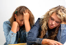 Two bored teen girls Royalty Free Stock Photography
