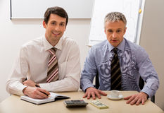 Two bosses make a business plan. Stock Image