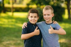 Two bothers spend time in park. They have fun and some relax befour school.  royalty free stock image