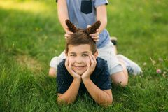 Two bothers spend time in park. They have fun and some relax befour school.  royalty free stock images
