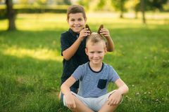 Two bothers spend time in park. They have fun and some relax befour school.  stock photos