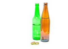Two bottle of beer and two caps on white Royalty Free Stock Images