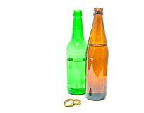 Two bottle of beer and two caps Royalty Free Stock Photo