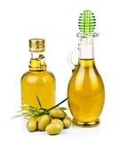 A two bottle of olive oil with olives on plate Royalty Free Stock Images
