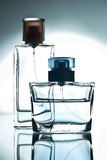 Two  bottle with perfume. Two bottles with perfume on a glass surface Royalty Free Stock Photo