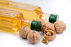 Two bottle of walnut oil and walnats Stock Photography