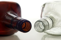 Two bottles. Two empty bottles lying on a white background Stock Photos