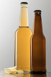 Two bottles of beer and chips Stock Photo